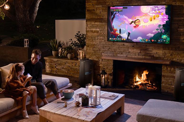 Enjoying outdoor TV in garden